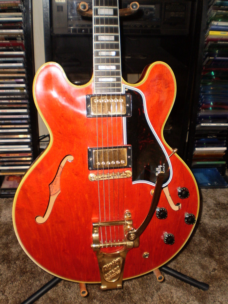 "Bill C. from an undisclosed location sent me this photo of his '60 mono ES-355. Look at the gold on that beauty. He must have worn gloves while playing. I always like the personalized touches folks put on their guitars-it gives them context and some small amount of history. This is a fairly early 60 so it still has the long guard and amber switch tip. It also has black non reflector knobs-a great look. I think it's the ""newer"" red but given the condition of the gold it may just have never seen the sun. Thanks Bill. Great addition to the site"