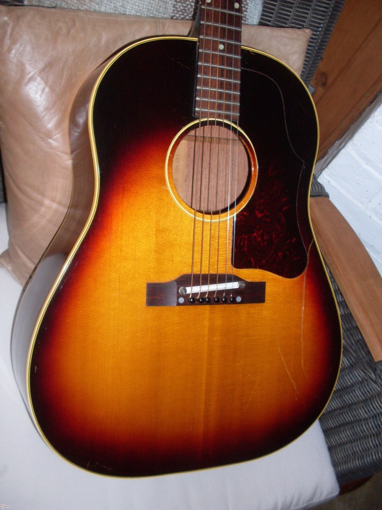 Great sounding 59 J-45 in real nice condition but for the two big scratches on the top. Cosmetic for sure and doesn't affect the spectacular tone of this old girl even with the adjustable bridge that everyone hates. Huge neck, excellent frets and a crappy soft case (original) $5000