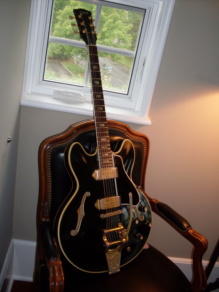 Factory Custom '66 ES-330 in black with ES-355 bindings and gold hardware. Has a headstock repair but is solid and stable. Probably one of a kind. $4900