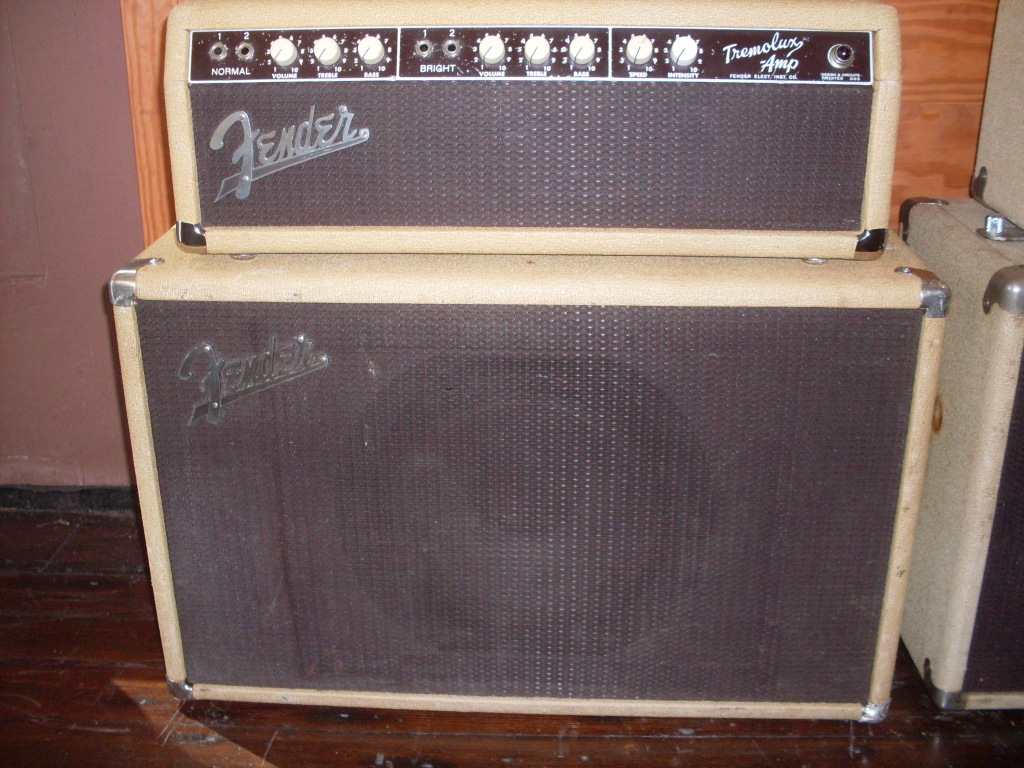 "Therewere a few versions of the white Tremolux. The first is that rare EL-84 version with the 10"" Tone Ring cabinet. The second is the 6L6 version with the same cabinet. Still rare but not as pricey as the EL-84 one. $2800"
