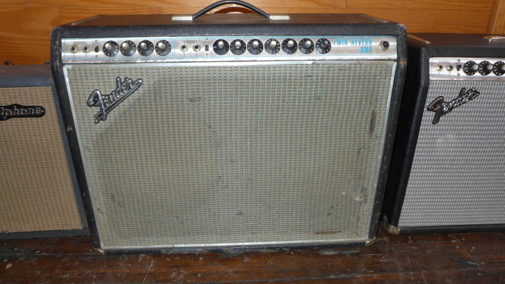69 Drip Edge Twin Reverb. Just serviced-new filter, bias and coupling caps. Still has its original Oxfords. Not my favorite speaker-I'd put in a couple of JBLs or Celestion Golds. Beat up but who cares.I t's cheap at $1300