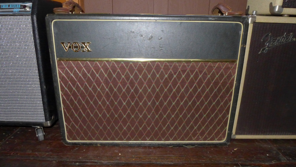 62 or 63 Vox AC30 (smooth Tolex). Mostly original-the brass vents had been replaced with plastic-now they're repro brass. Handles are probably not original. Speakers are original blue Celestions. Original iron and most of the caps. Grill cloth looks too good to be original. $4800