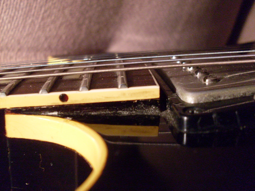 This 64 ES-335 shows about an equal amount of neck under the fingerboard as there is fingerboard. Maybe a little more. This is a pretty typical neck angle for a post 1960 ES-335.