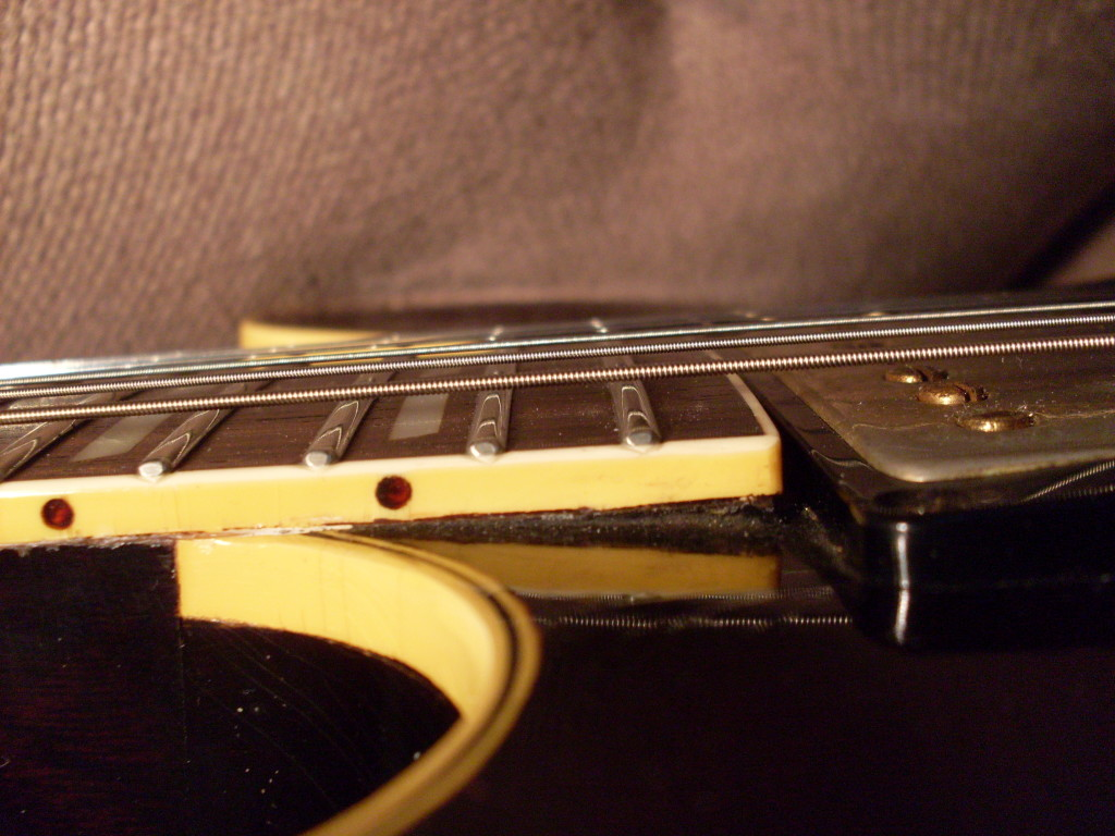 Here's an early 59 ES-345 that shows a lot less wood under the binding meaning the neck angle is shallower. Some 58's show no neck at all under the fingerboard. This angle affects how low the bridge needs to be for the guitar to set up properly and comfortably.