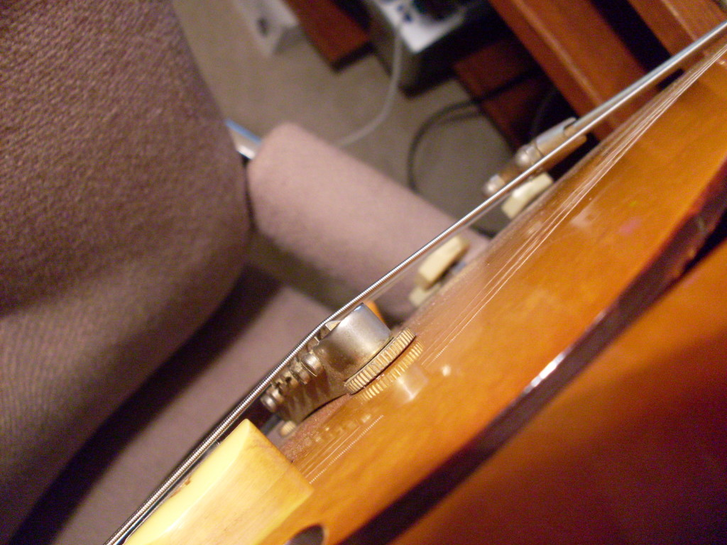 This is the bridge on my 59 Epi Sheraton which follows the same rules as a 3x5. It has an extremely shallow angle and the bridge sits as low as I can get it, touching the top of the guitar. This could be a good thing.