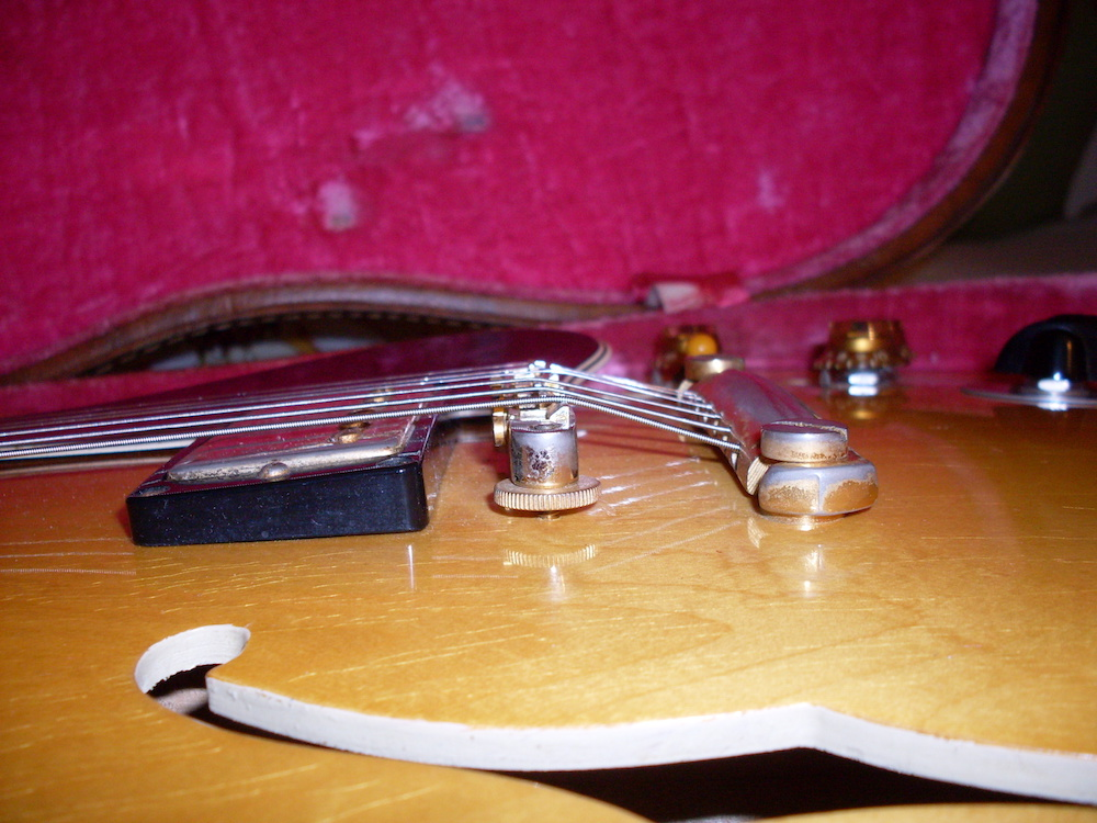 The pickups can be set pretty close to the strings. Start high and back off to find the tone that suits you.